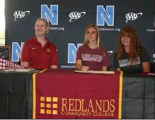 Todd Newville/The Newcastle Pacer Newcastle cross country runner Haleigh Mercer signed a letter of intent on Thursday, May 2, to attend Redlands Community College in El Reno next year.  From left to right are Redlands coach Natalie Cox, Haleigh Mercer, a