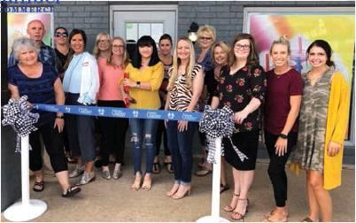 Photo provided/For The Newcastle Pacer The Newcastle Chamber of Commerce rolled out the blue ribbon for the owners of The Smoothie Lounge to cut. The special event was held Thursday, Sept. 12 at their location off of Main Street.