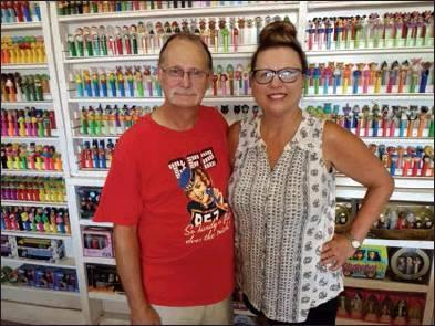 Todd Newville/The Newcastle Pacer Paul and Jana Davies pose together in front of the display of Paul's 2,000-plus and counting collection of PEZ dispensers.