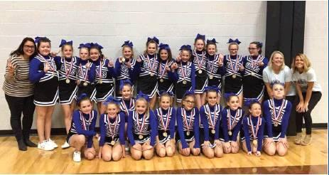 Photo provided                                Congratulations to the sixth grade Racer cheer squad for placing first in last weekends competition in Tuttle. From left: Coach Jill Clark, Kaitlynn McCurley, Sydney Barnes, Emma Hollars, Ava Miller, Syd