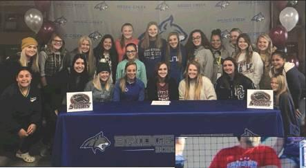 Photo provided by Bridget Watkins                                Aubrey DePron has signed a letter-of-intent to play softball for the Salukis of Southern Illinois University in Carbondale, Ill. DePron was the state runner-up in the long jump and ran