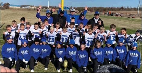 Photo by Jennifer Lewis/J. Lewis Photography                                The third grade Racer football team claimed victory over the Noble Bears with a 26-0 win last Saturday. This is their third consecutive championship title. The class of 2028