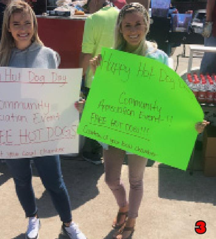 3.Summer Cotner and Brynlee Cotter proudly advertise the event with their signs.
